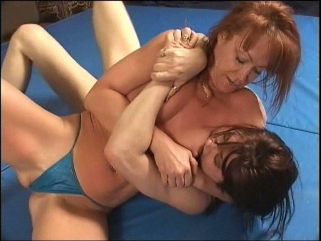 Competitive female wrestling pinned into submission